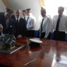 Chairman of the RNLI - Charles Hunter-Pease cutting Paul's Cake